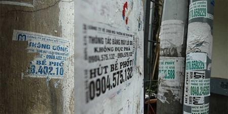 Số điện thoại dịch vụ hút bể phốt lừa đảo xuất hiện tràn lan tại các vách tường, cột điện